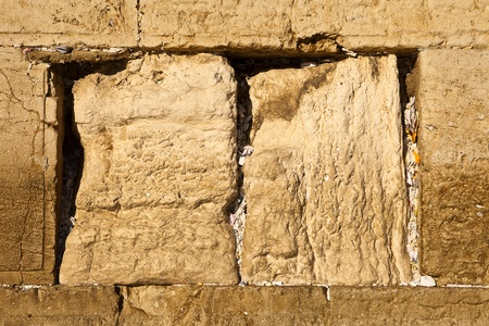 Small papers are stuffed into every nook and cranny between stones on the Western Wall in Jerusalem with prayers from people all over the world.
