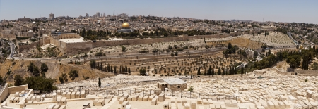 A panoramic view of the Old City of Jerusalem from the Mount of Olives. The old city wall, the Dome of the Rock, and other landmarks are all visible from this location. photo