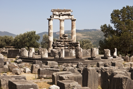 goddesses: The ruins of the Sanctuary of Athena at Delphi are located around the circular central portion of the temple