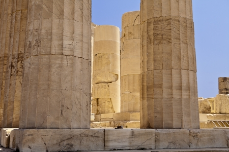 A detail view of a set of pillars at the Parthenon in Athens glowing with reflections of the white marble in the mid-day light  photo