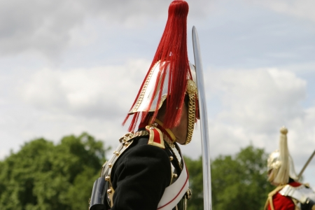 occurs: London, England - July 8 , 2006: A guardsman of the British Royal Cavalry on the parde grounds. This image is typical of the exercise performed during the traditional changing of the guard that occurs every day. Editorial