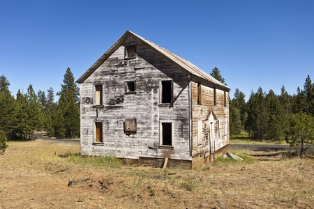 clearing: Oregon - August 1, 2012: An old, weatherbeaten building that served as the main bunkhouse for an old cinnabar mine that is slowly decaying in the Ochoco Mountains in Central Oregon.