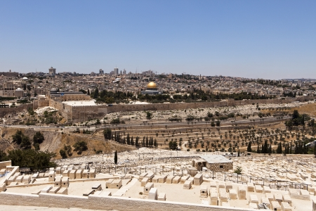 A cityscape of the Old City of Jerusalem from the cemetery on the Mount of Olives  The Islamic mosque of the Dome of the Rock is in the center with the gold dome  photo