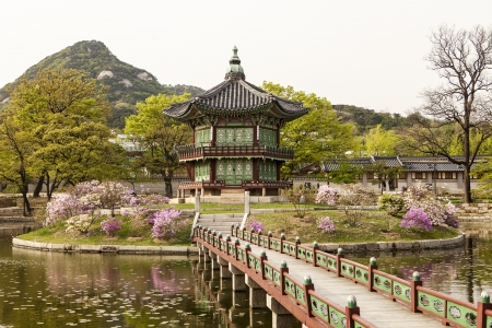 south korea: SEOUL, KOREA - April 27, 2012: The Pavilion of Far-Reaching Fragrance is a small pagoda on an artificial island in the center of a small lake in the Gyeongbokgung Palace complex in Seoul.