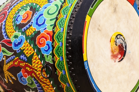 A detailed view of the ornamental paint patterns on a ceremonial drum seen in the Gyeongbokgung Palace complex  The drumhead skin shows the blurred marks made when it is struck  Stock Photo
