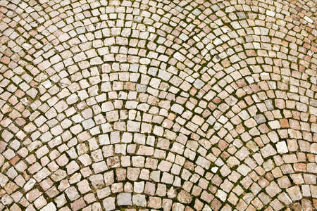 Cobblestones on a Czech street in Prague have been laid out in a pattern of concentric arcs