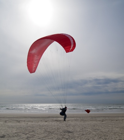 airfoil: Gearhart, Oregon - May 15, 2010: An unidentified woman about to take off on a recreational paragliding run over the beaches at Gearhart, Oregon.