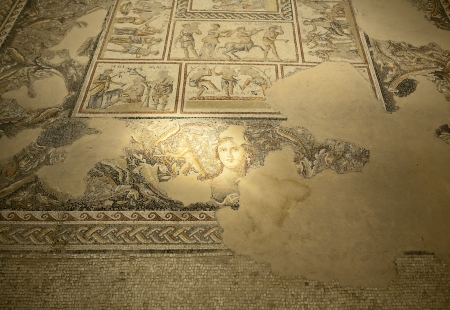 mosaic: A patch of sunlight illuminates the mosaic of the head of Dionysus in the ancient Roman villa in the historic city of Zippori in Israel.