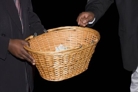 township: A basket being passed around at a Methodist Church in a South African township to collect donations  Stock Photo