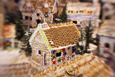 A classic gingerbread house in the middle of a candy village  Special lens effect is intentional to emphasize the dreamy nature of the display  photo