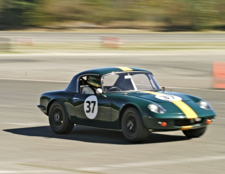 racecar: Auburn, Washington - September 25, 2005: An old vintage green Lotus race car moving at high speed during a road race. Editorial