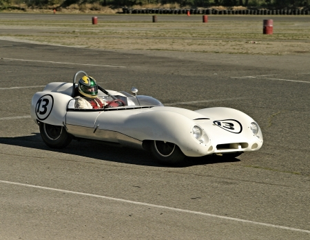 racecar: Auburn, Washington - September 25, 2005: A vintage white Lotus racecar on a race track. The car was moving at speed during a road race.