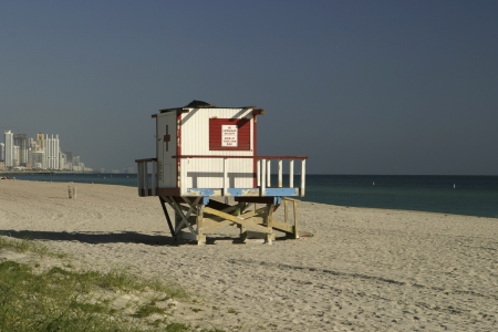lifesaving: A view of a lifeguard tower on North Miami Beach together with the beach and some of the apartment towers  At this hour of the morning, the tower was vacant  The sign says