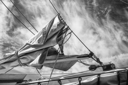 scanned: A canvas sail furled on the bow of a sailboat   Scanned from color film and converted to black and white