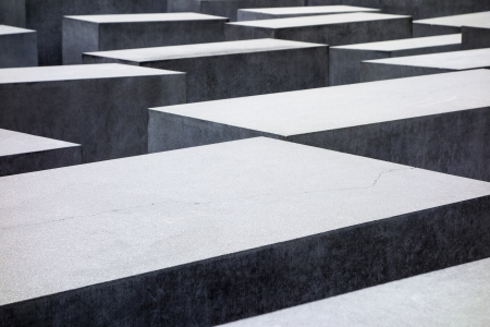 murdered: BERLIN, GERMANY - FEBRUARY 3, 2013  An abstract view of the tops of the some of the stones in The Memorial to the Murdered Jews of Europe as seen in Berlin on February 3, 2013  The landmark, also known as the Holocaust Memorial, is a remembrance in Berlin
