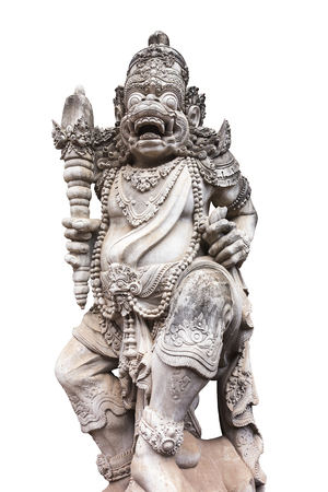 A carved statue with fine details that stands outside the entrance to a Hindu temple as a guardian   Isolated to white