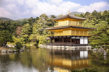 rokuonji: Kyoto, Japan - November 5, 2013  A viewpoint of the Golden Pavilion, or Kinkaku, with a reflection of the building and gardens over the pond at the Rokuonji complex on the outskirts of Kyoto in Japan  The World Heritage site is covered in gold leaf