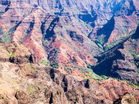 waimea canyon state park: Ridges of Waimea Canyon showcase the rugged volcanic terrain  The canyo on the island of Kauai is the deepest canyon in the state of Hawaii