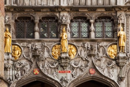 entranceway: Gilded stone statues decorate the entrance over the doors to the Basilius, or Basilica of the Holy Blood, in Bruges, Belgium  Stock Photo