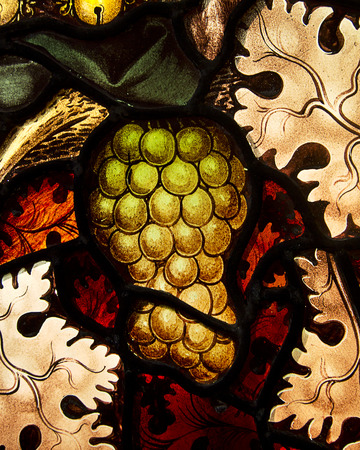 richly: A small portion of a stained glass window in the Church of St  Mary The Virgin in Oxford, England that highlights a richly detailed design of a ripe grape cluster   Stock Photo