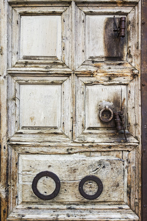 The old wooden door to the Church of the Holy Sepulchre in the Old City of Jerusalem in Israel  photo