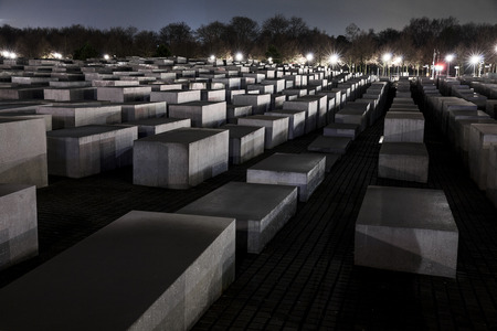 BERLIN, GERMANY - FEBRUARY 4, 2013   The Memorial to the Murdered Jews of Europe, also known as the Holocaust Memorial, is a remembrance in Berlin to the Jewish victims of the Holocaust  It consists of 2,711 concrete slabs or stelae arranged in a grid pat