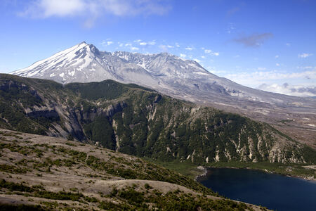 A view inside the crater of Mt  St  Helens looking over a low mountain ridge and a corner of Spirit Lake  photo