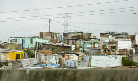 A view of an informal settlement or township near Cape Town, South Africa  The small homes are built of scraps of tin and plywood to provide shelter
