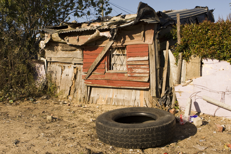 Wallacedene, South Africa - August 5, 2008  A typical shanty home in a South Africa township that is representative of the housing found in the informal settlements that are located around the edges of many cities throughout the country