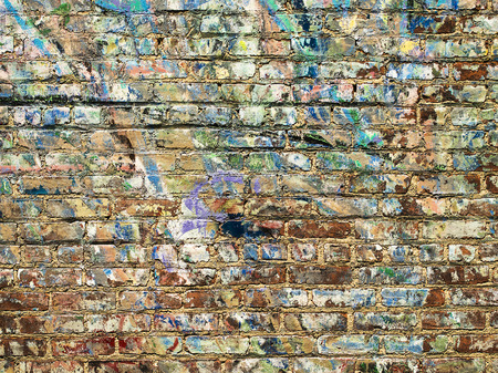 A background image of paint splattered on a brick wall in New York City near the High Line Park  Stock Photo