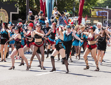 solstice: SEATTLE, USA - JUNE 21, 2014 - A performance dance troupe wearing cabaret costumes performs in the 2014 Annual Fremont Summer Solstice Day Parade in Seattle on June 21, 2014  The parade celebrates the start of summer  Editorial