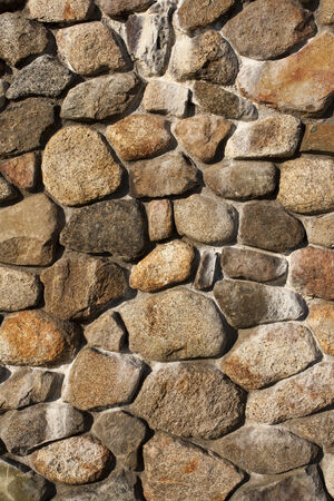A pattern created from the exterior wall of a fireplace made of rounded rocks from an old river bed