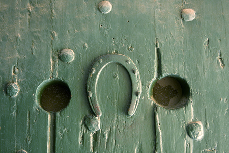 An upside-down horseshoe that is nailed to a prison cell door in the Castle of Good Hope in Cape Town, South Africa. This symbol is often taken to mean that someone Imagens