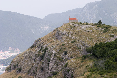 promontory: A small, one room church is located right at the edge of a rocky promontory on the Montenegro coast near Vrba and Sveti Stefan.