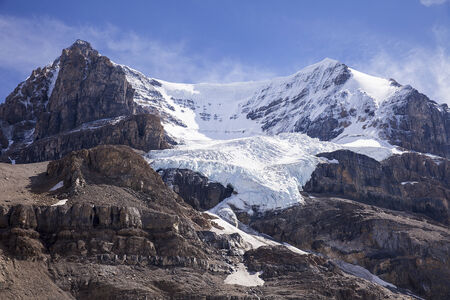 The glacier on Mount Andromeda in Alberta, Canada is formed by snow and ice that fall into the funnel formed by the steep slopes of the main bowl. The glacier has been retreating over the last forty years.