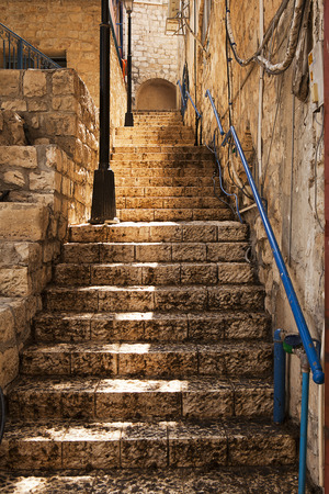 mysticism: A narrow stone staircase rises through the back alleys of Zefat with a bit of glow on the limestone. Zefat is a historic town in Isreal, known for its mysticism and the scholarship of the people who studied there.