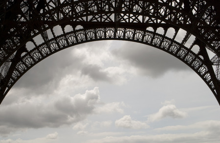 ironwork: A detailed view of the ironwork on the main arches of the Eiffel Tower. Stock Photo