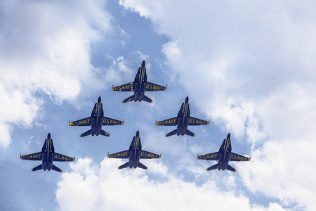 f 18: SEATTLE, USA - AUGUST 2, 2014: The Blue Angels perform in a formation of six planes during the annual SeaFair festival and airshow over the Seattle skies on August 2, 2014. The Blue Angels are the oldest aerobatic flying team in the world.