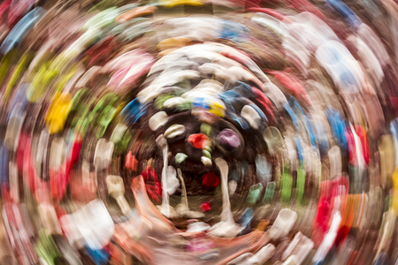 wads: Abstract image of chewed wads of gum on the landmark gum wall at the Pike Place Market in Seattle that is formed by a circular motion blur. Stock Photo