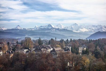 munch: A view of the Swiss Alps as seen over the outskirts of Bern. In the center of the peaks are the Eiger, the Munch and the Jungfrau mountains. Stock Photo