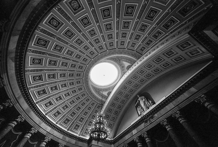 ceiling: WASHINGTON DC, USA - AUG 17, 2014: A wide angle view of the ceiling of the rotunda of the United States House of Representatives chambers in the US Capitol building shows the ceiling panels and the oculus of the dome. (Scanned from black and white film.) Editorial