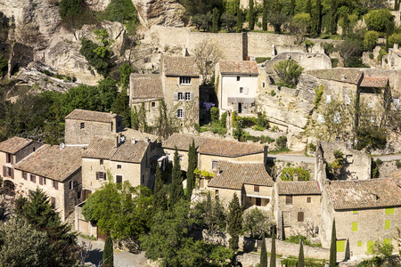 luberon: A neighborhood section of the old part of Gordes a picturesque village in the Luberon area of France sits below a range of rocky cliffs. Stock Photo