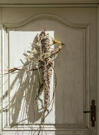 luberon: Dried herbs decorate the door of a home in Goult in the Luberon area of Provence in Southern France. Stock Photo