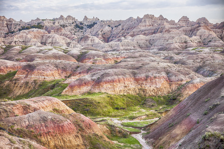 The Yellow Mounds area of the Badlands is characterized by the yellow and red colors of the weathered and eroded mud of the ancient sea floor.
