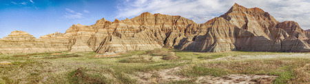 arroyo: A largescale panoramic view of a part of Badlands National Park in South Dakota showcases the grasslands and the hills of the area. Stock Photo