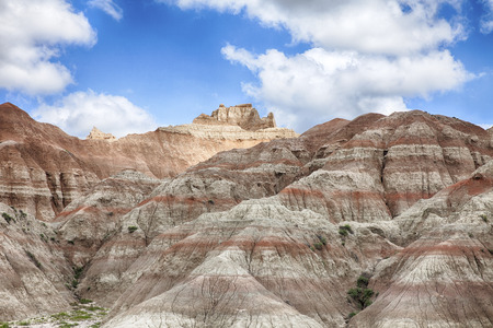 badland: The hills in the South Dakota Badland are created from erosion through layers of soft rock and mud. The hills look much larger than they really are. Stock Photo