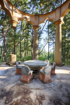 afterglow: ROCHE HARBOR USA  JUNE 18 2015: The stone table and chairs are the centerprice of the Afterglow Mausoleum near Roche Harbor Resort on San Juan Island. The memorial is built according to Masonic Temple symbolism including the missing pillar. Editorial