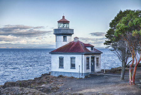 The Lime Kiln Point Lighthouse watc hes over Haro Strait and the Straits of Juan de Fuca. It is known as one of the best places from shore to watch the southern resident Orca whales.