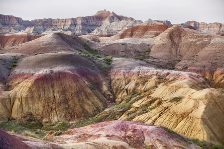 sediments: Bright colors exist in the Yellow Mounds area of the Badlands National Park. The hills here are characterized by the yellow and red colors of the weathered and eroded sediments of the ancient sea floor.