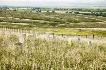 Gravestones in the cemetery look out over the battlefield at Little Bighorn in Montana where General George Custers 7th Cavalry and the Lakota Sioux fought a fierce battle in 1876. Imagens